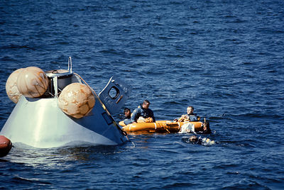 19 Oct. 1968) --- The prime crew of the Apollo 8 mission in life raft awaiting pickup by U.S. Coast Guard helicopter during w...