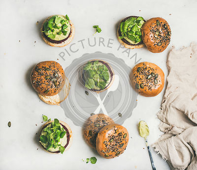 Healthy burgers with beetroot patties and green sprouts, top view