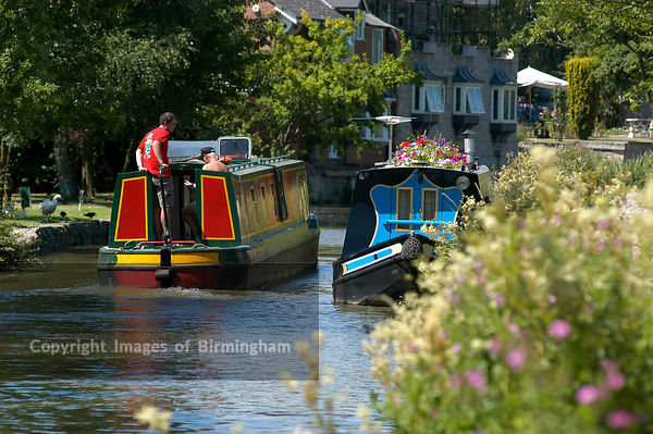 Boats at Stratford upon Avon, Warwickshire. Swans and riverboats, river Avon. Canal barge.