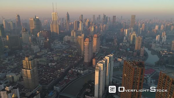 Shanghai Skyline in the Sunny Morning. Puxi District. China. Aerial High Altitude View. Drone is Flying Backward. Establishin...