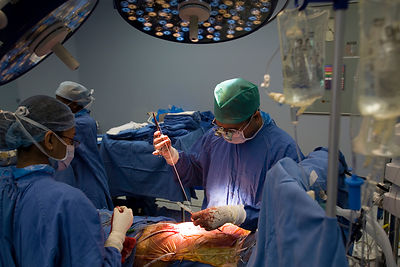 India - Gurgaon - Doctors perform surgery in a state of the art operating theatre in the Medicity