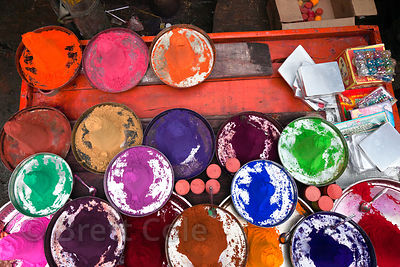 Colorful gulal powders on a street vendor's cart, Pushkar, Rajasthan, India