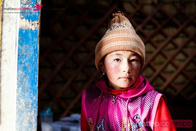 Portrait of young kyrgyz girl inside a yurt