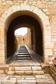 Archway to inner courtyard of the Kasbah. Le Kef, Tunisia; Portrait
