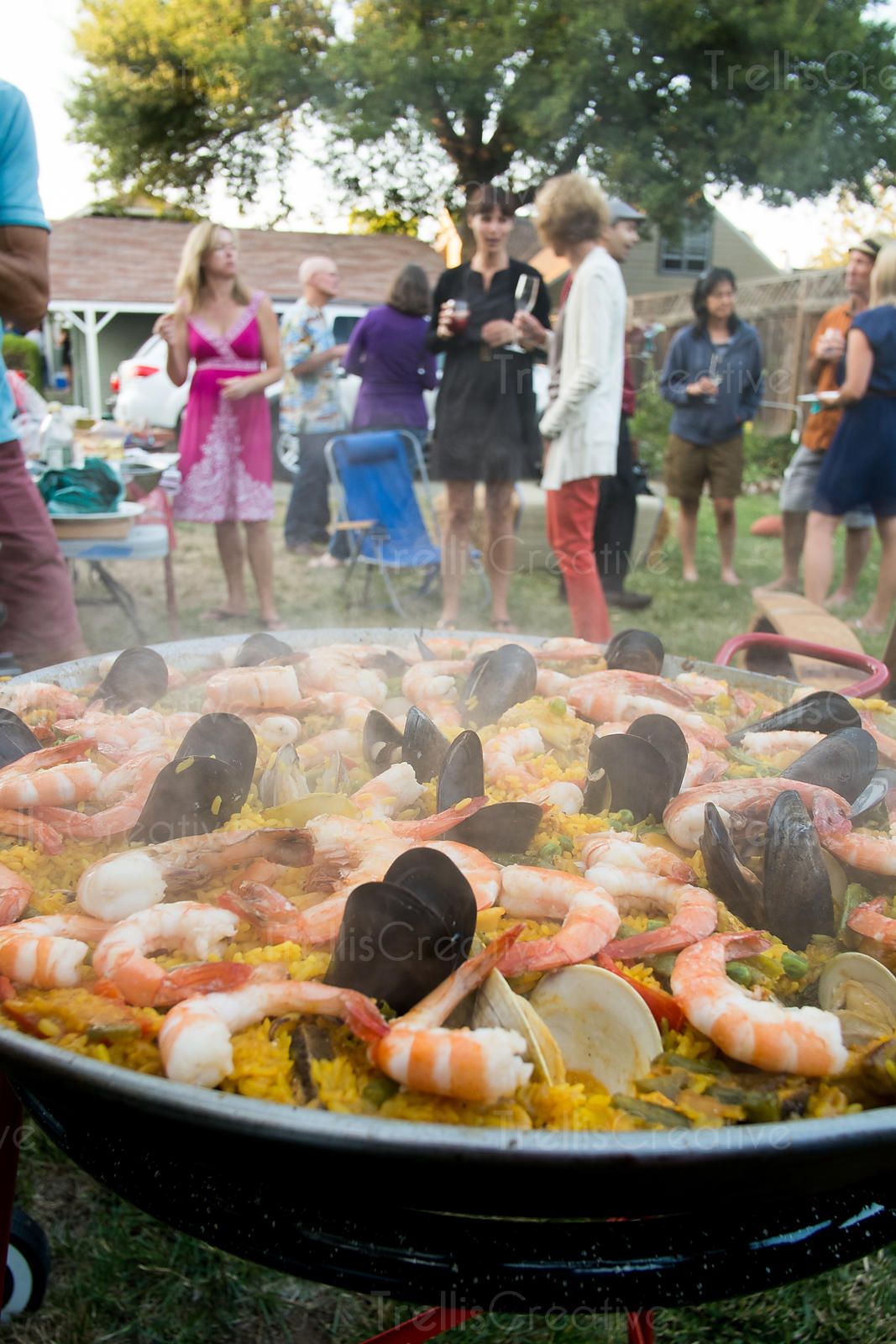 Backyard party with seafood paella