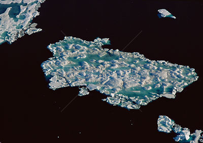 Aerial view of sea ice breaking up in late spring, Lancaster Sound, Canadian Arctic
