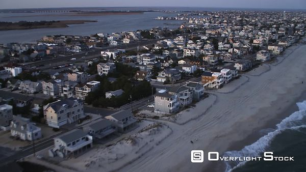 Flying over densely populated Long Beach Island, New Jersey at dusk. Shot in November