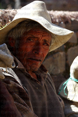 Tired man takes a break from hauling new foundation ropes across the canyon , Q'eswachaka , Canas province , Peru