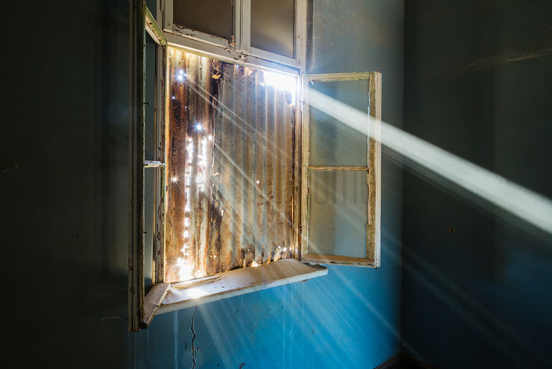 Sunbeams Shining Through Window in Abandoned House