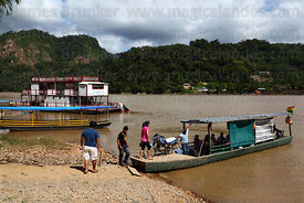Boarding the local ferry across River Beni to San Buenaventura , Rurrenabaque , Bolivia