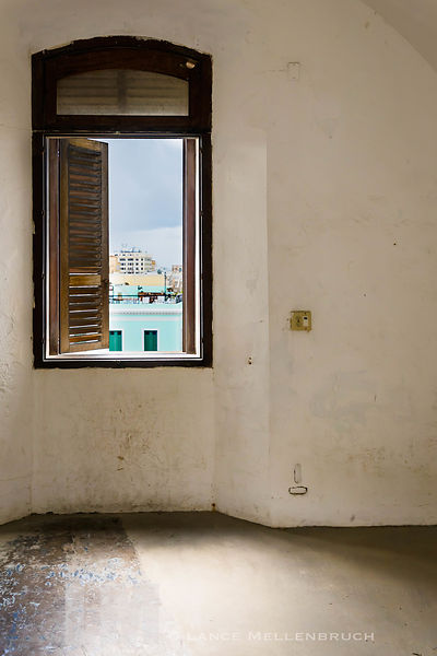 Window in room at Castillo San Cristóbal showing view of San Juan Bay