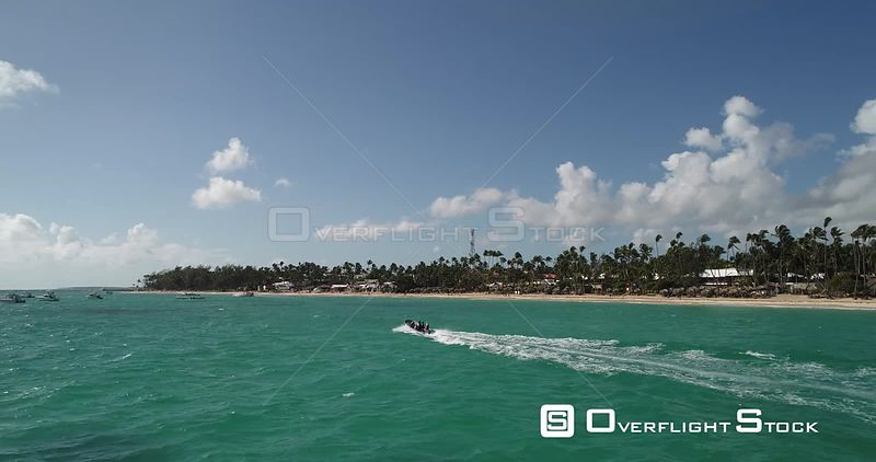 Behind the Boat. Fast flight low level small motor boat. Punta Cana, Dominican Republic