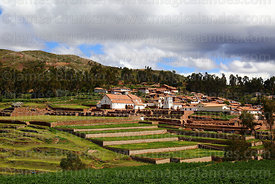 View of village, Spanish colonial church and terraces of Inca site, Chinchero, near Cusco, Peru
