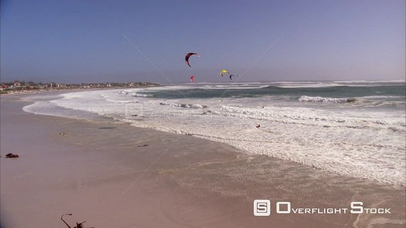 Aerial shot of a power kite and kite surfers riding on the waters. Eastern Cape South Africa