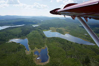 Aerial view of lakes in the Northern Rockies from a de Havilland Canada DHC-3 Otter Turbo, Muskwa-Kechika Protected Area, Bri...
