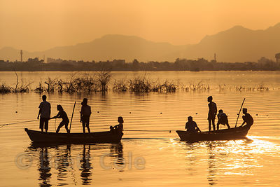 Fishing boat on Ana Sagar lake at sunrise, Pushkar, Rajasthan, India