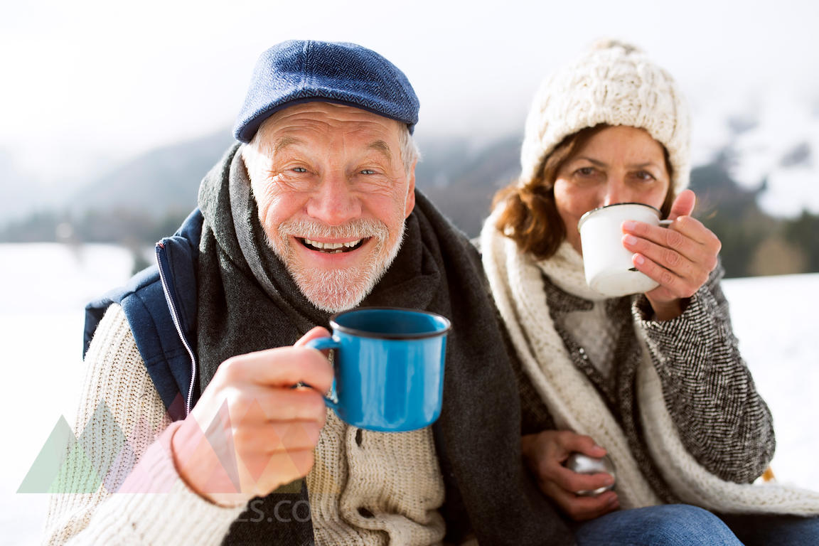 Portrait of senior man with hot beverage in winter