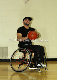 Young man playing wheelchair basketball