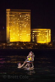 Families immerse idols of Ganesh into the Arabian Sea at night during the Ganesh Chaturthi festival in Mumbai, India.