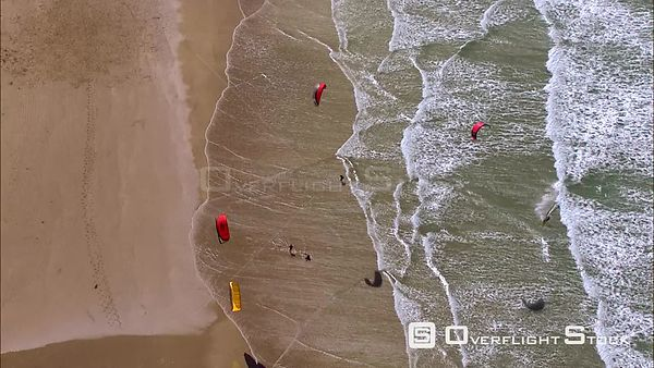 Aerial of kite surfers on a beach and in the sea. Eastern Cape South Africa