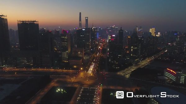 Shanghai Skyline at Twilight. Lujiazui District and Century Avenue. Aerial View. Drone is Flying Forward and Upward. Establis...