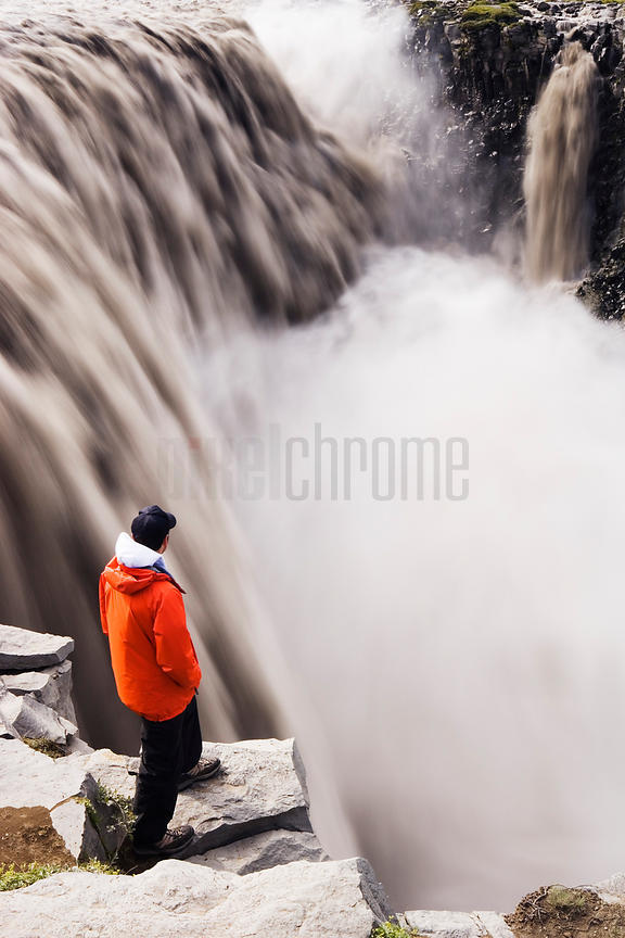 Tourist Standing Above Dettifoss (Dirty Falls), Iceland