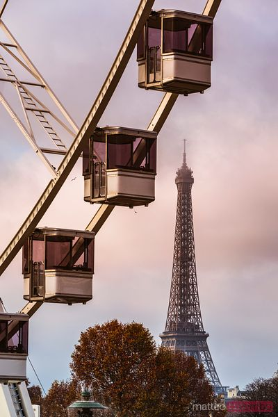 Eiffel tower and Ferris wheel at sunset, Paris, France