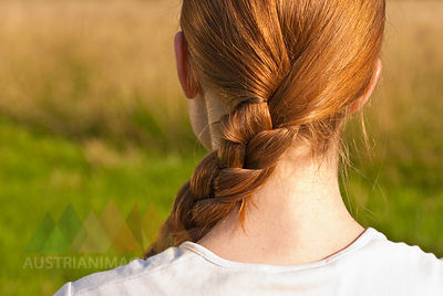 Germany, Bonn, Woman with braided hair, rear view