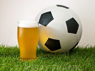 Football and a pint on grass