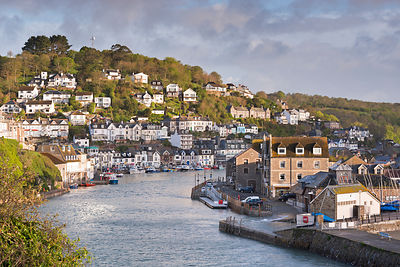 Cornish fishing town of Looe in morning sunshine, Cornwall, England, UK. May 2015.