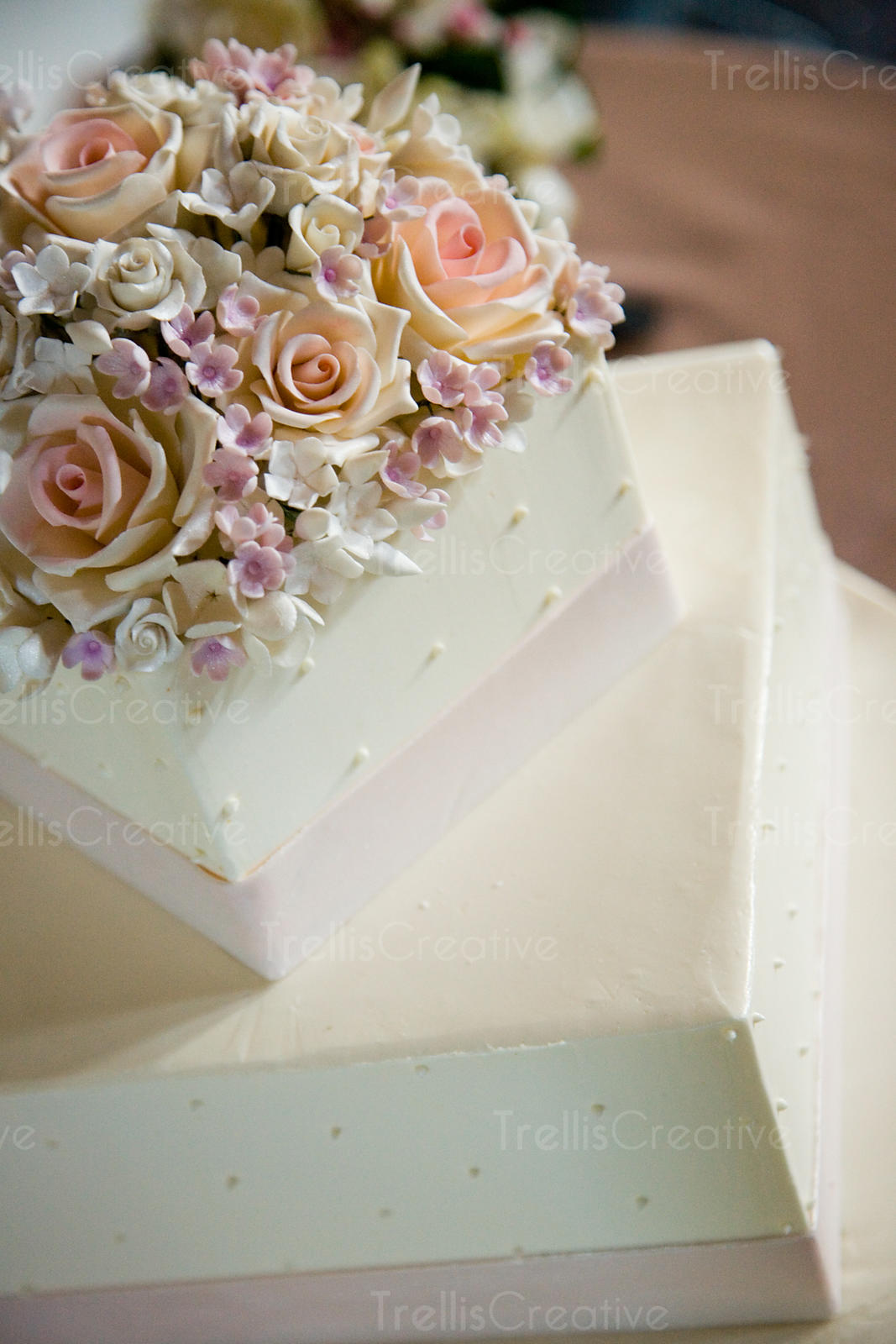 Square wedding cake made of white fondant