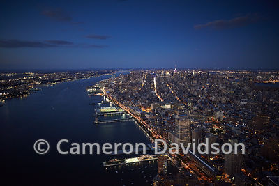 Aerial view at night of Lower Manhattan and the Hudson River