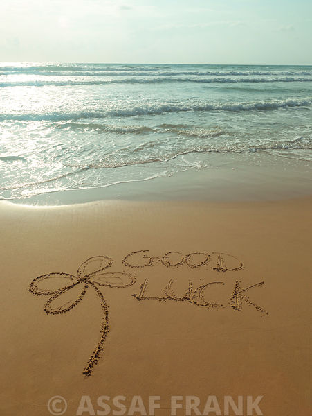Good luck with flower  - Beach writing