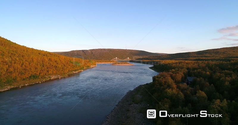 Autumn River, Aerial Decreasing View of Tenojoki River and Border Bridge Between Norway and Utsjoki Town, on a Sunny Autumn D...