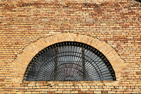 Brick wall and arched window of San Francisco convent, Tarija, Bolivia