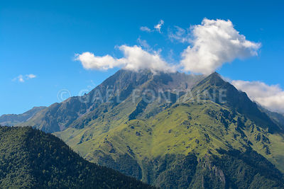 Peak of Pyrenean mountains with a blue sky, France