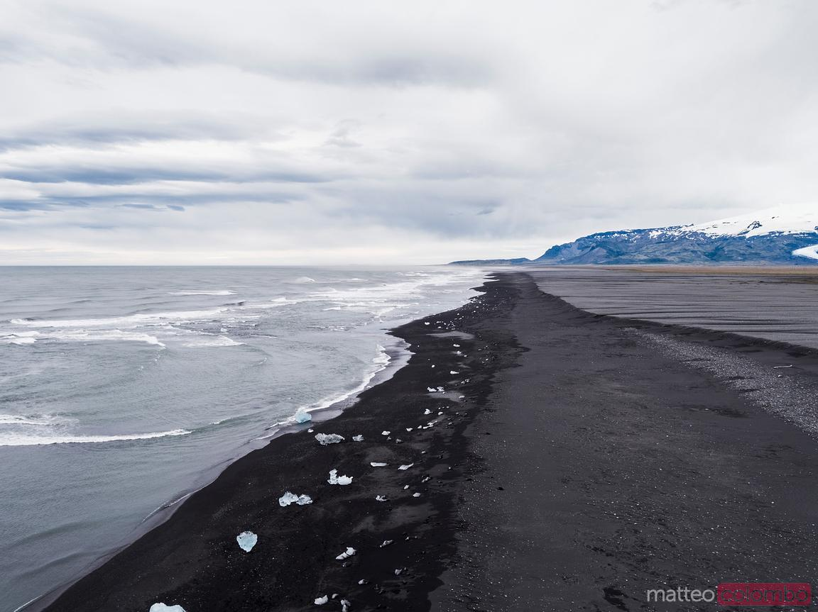 Aerial drone view of black sand beach, Jokulsarlon, Iceland