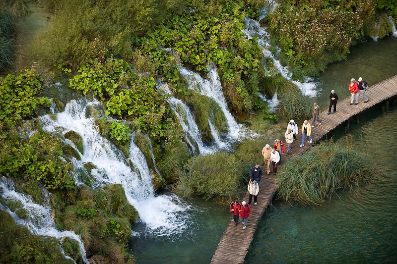 People on walkway above water, Velike kaskade, Lower lakes, Plitvice Lakes National park, Croatia, October 2008