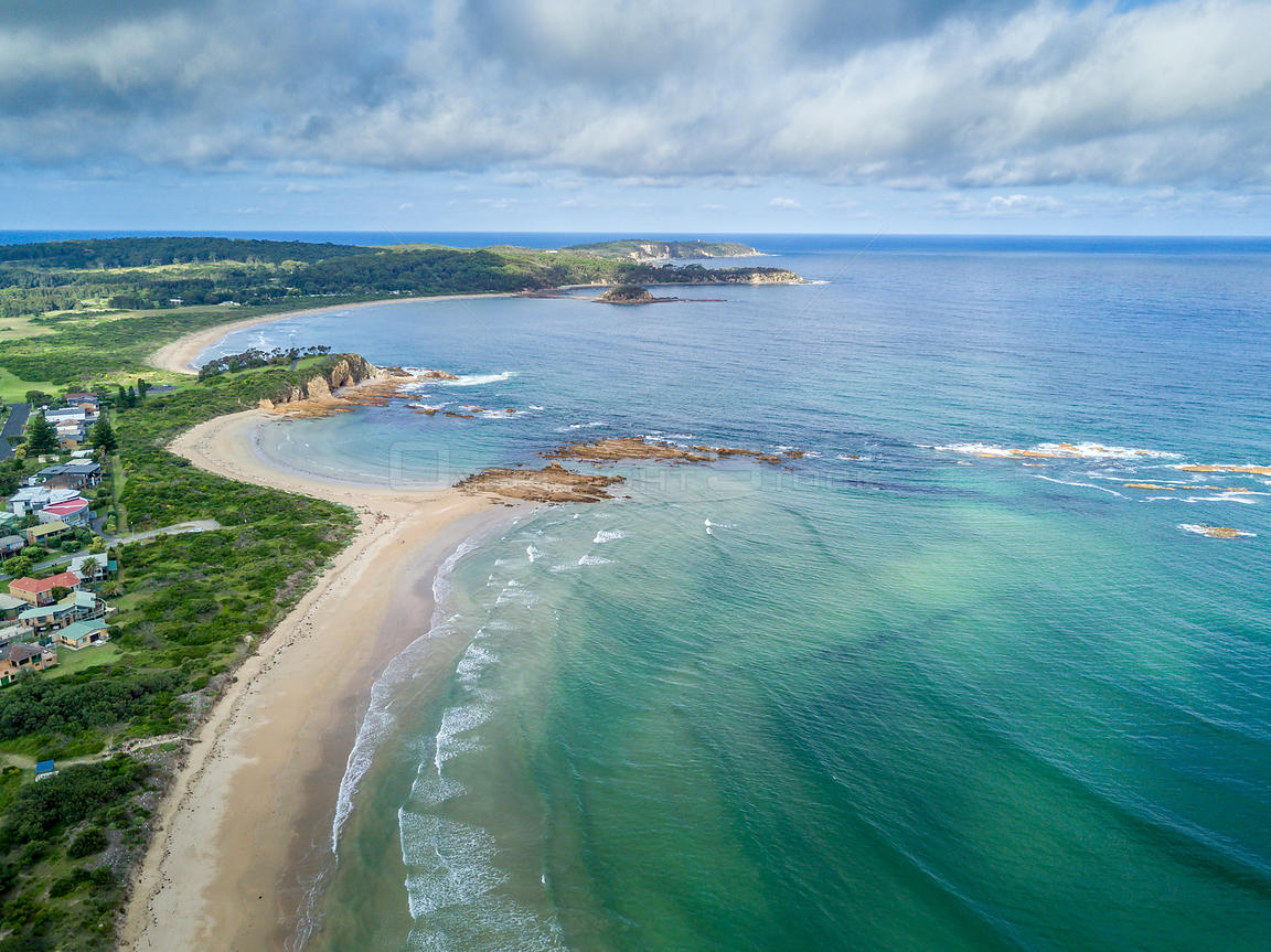 Beautiful crystal clear beaches of the south coast backed by lush green landscape. NSW Australia