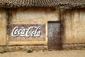Coca Coca mural on wall of colonial building, Tarata, Cochabamba Department, Bolivia