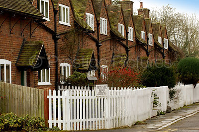 Terrace of Old Cottages with White Picket Fence