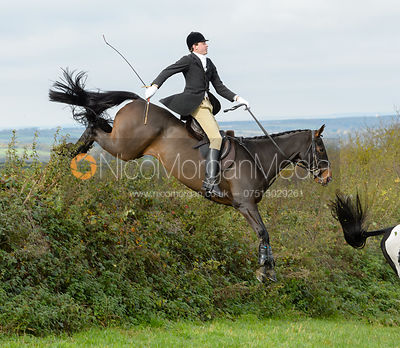 George Ward jumping a hedge above Clawson Thorns