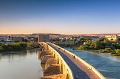 Roman bridge and Calahorra tower at sunrise, Cordoba, Spain