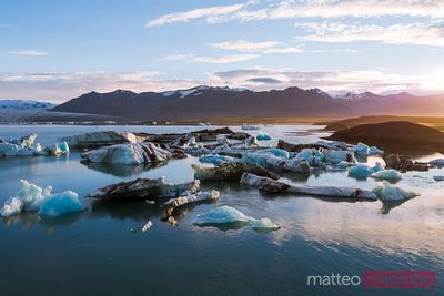 Aerial drone view of Jokulsarlon glacial lake at sunrise, Iceland