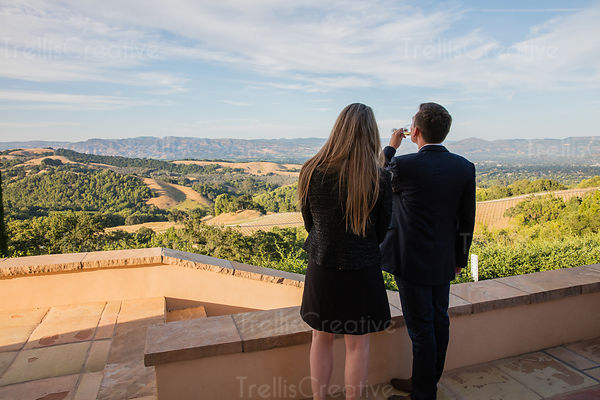 Couple enjoying wine while looking at the view of  Napa Valley vineyards