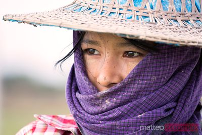 Portrait of young woman working in a rice field, Myanmar