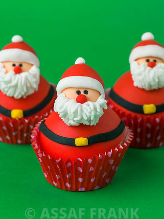 Three father christmas cupcakes