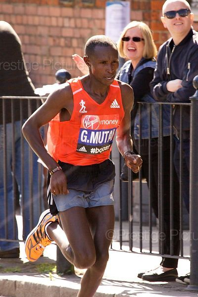 Geoffrey Mutai (6th) Running in  the Virgin 2014 London Marathon