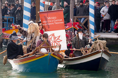 Mountain People in the Lagoon - Trentina Museum in the Venice Carnival Water Parade  on the Rio di Cannaregio Canal
