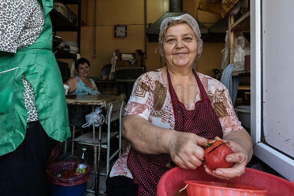 Woman Peeling Tomatoes at the Karayan Market